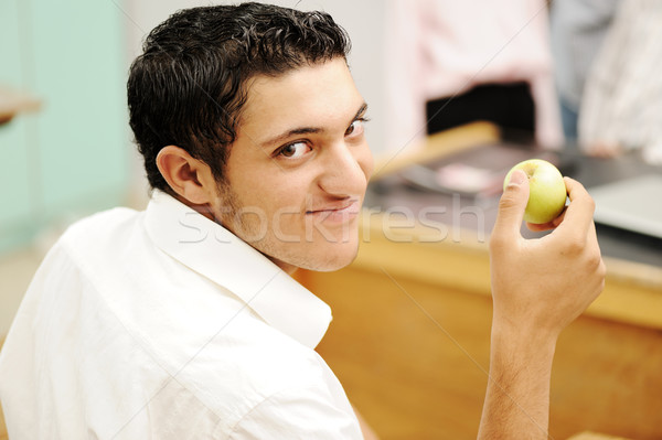 Student in collage with an apple in hand smiling Stock photo © zurijeta