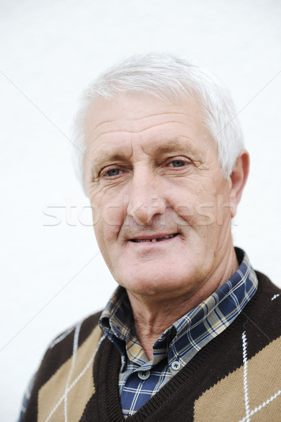 Closeup Profile on a good looking smiling Old Man Stock photo © zurijeta