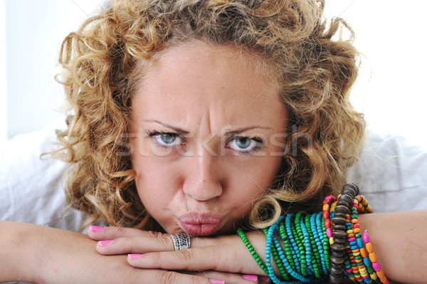 Teen girl with angry grimace Stock photo © zurijeta