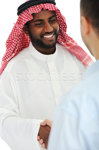 Arabic and european american business man making a deal and hand Stock photo © zurijeta