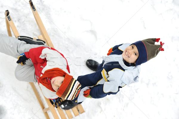 Kids sliding sledge in the snow Stock photo © zurijeta