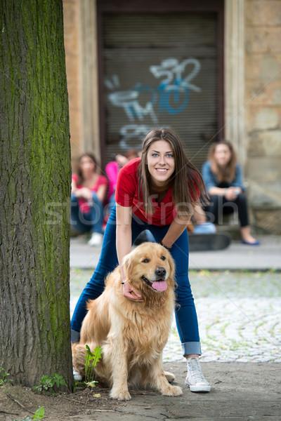Handsome young gurl cuddling a puppy Stock photo © zurijeta