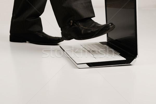 Business shoe steping and destroying laptop Stock photo © zurijeta