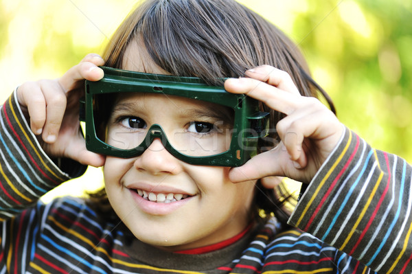 A little pilot, cute little kid outdoor with glasses on eyes Stock photo © zurijeta
