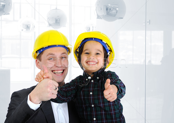 Happy boss and employee together, father and son engineers on work playing Stock photo © zurijeta
