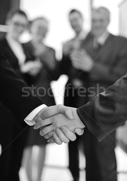 Succesful handshake with business people aplauding Stock photo © zurijeta