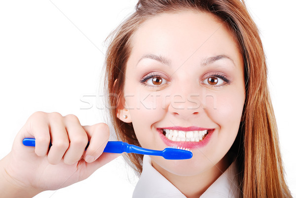 Beautiful attractive girl brushing her very  bright and white teeth Stock photo © zurijeta