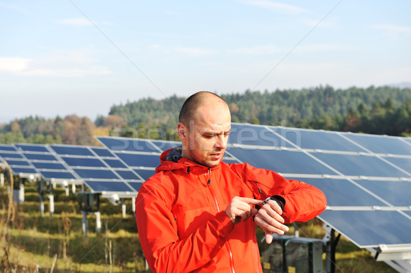 Male worker at solar panel field Stock photo © zurijeta