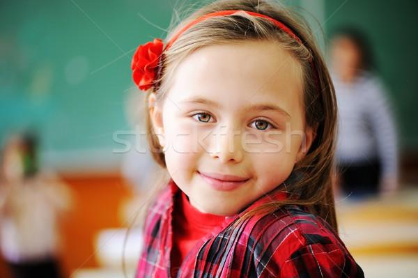 Aranyos iskolások osztályterem oktatás tevékenységek virág Stock fotó © zurijeta