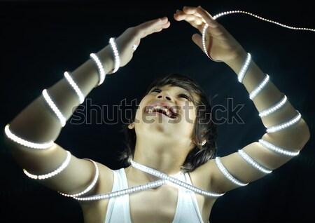 Portrait of kid with led strip light Stock photo © zurijeta