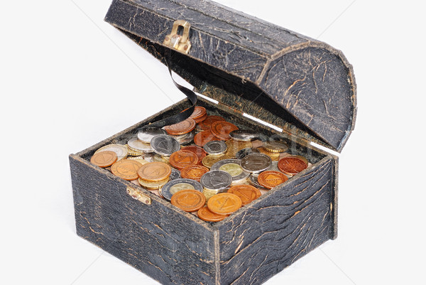 Many coins in one old chest isolated Stock photo © zurijeta