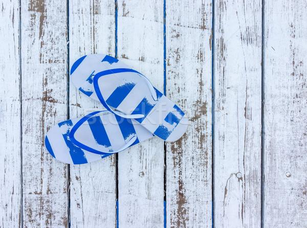Flip-flops on beach Stock photo © zurijeta