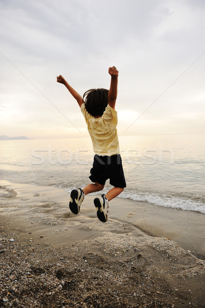 Happy jumping on sea Stock photo © zurijeta