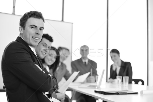 A group of business people  in a conference room Stock photo © zurijeta