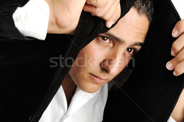 Portret ernstig jonge man hoofddoek jas Stockfoto © zurijeta