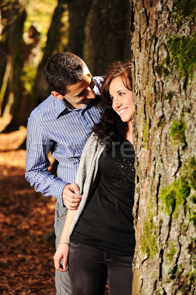 Lovers teenagers in nature talking with each other and falling in love :) Stock photo © zurijeta