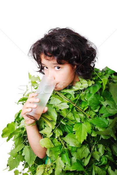 Nice little girl in leafs cloths drinking water Stock photo © zurijeta