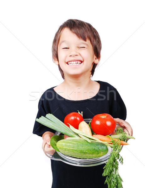 Boy with vegetables in hands Stock photo © zurijeta