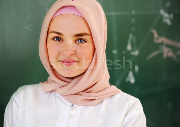 Casual Muslim Arabic student looking happy and smiling Stock photo © zurijeta