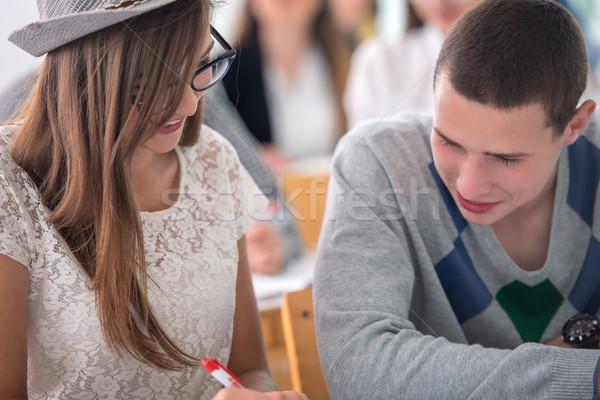 Aranyos iskolás lány tanul osztálytárs mosolyog osztályterem Stock fotó © zurijeta