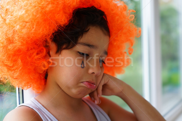 Abandoned kid with clown hair wig Stock photo © zurijeta