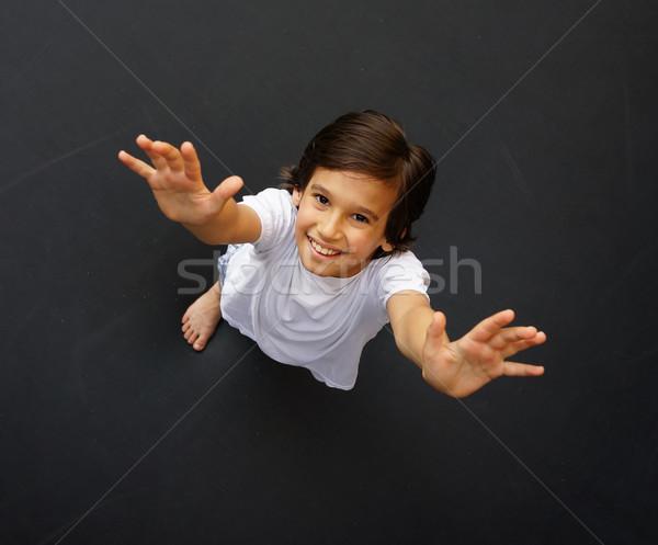 Kid springen hoog omhoog kind trampoline Stockfoto © zurijeta