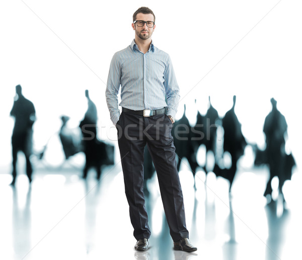 Business man standing on airport with traveling people in backgr Stock photo © zurijeta