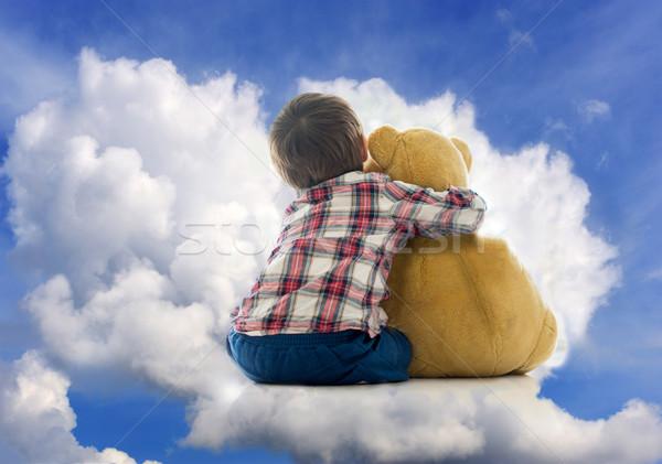 Boldog kicsi gyerek játszik medve játék Stock fotó © zurijeta