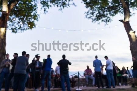 Tömeg emberek együtt szabadtér vár naplemente Stock fotó © zurijeta