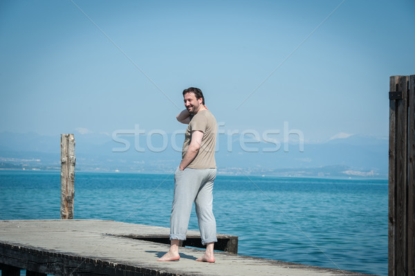 Adult man enjoying summer vacation on sea Stock photo © zurijeta