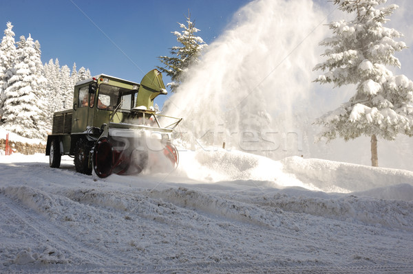 Special winter vehicle for removing snow from road in action Stock photo © zurijeta