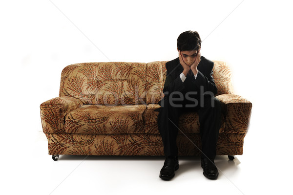 An emotional image of a teenage boy sitting alone Stock photo © zurijeta