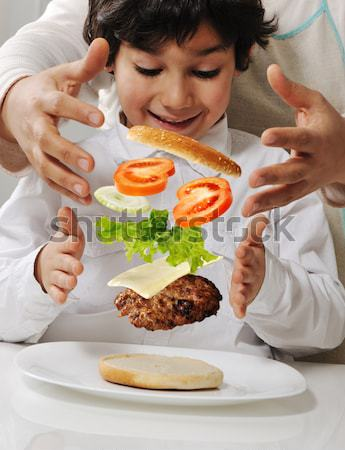 Mother and son making burger at kitchen Stock photo © zurijeta