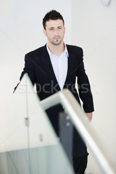 Successful business people walking up stairs Stock photo © zurijeta