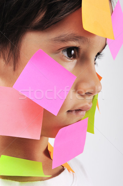 Little boy with memo notes on his face Stock photo © zurijeta