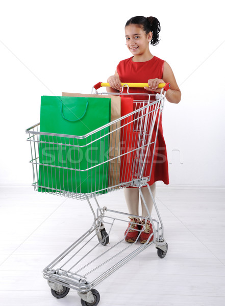 Little girl shopper in red dress with shopping cart Stock photo © zurijeta