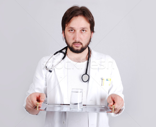 Young male doctor in white standing Stock photo © zurijeta