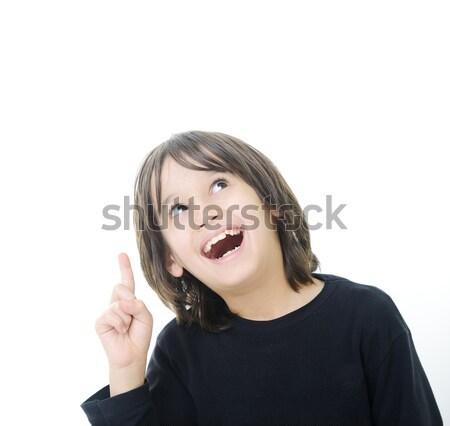 Educational theme: boy teenager showing upward Stock photo © zurijeta