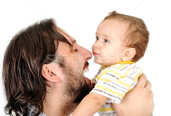 Happy young man holding a smiling 1-2 years old baby Stock photo © zurijeta
