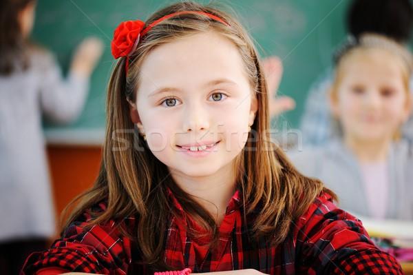 Aranyos iskolások osztályterem oktatás tevékenységek mosoly Stock fotó © zurijeta