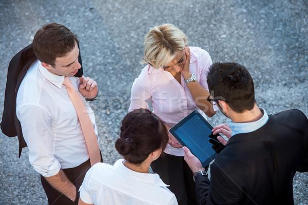 Quattro corporate gente che parla sopra view strada Foto d'archivio © zurijeta