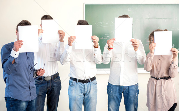 Highschool students holding sheets of paper Stock photo © zurijeta