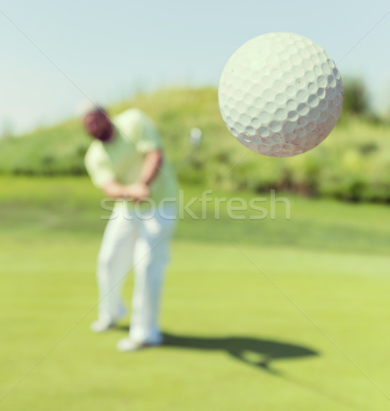 Successful man playing golf at club Stock photo © zurijeta