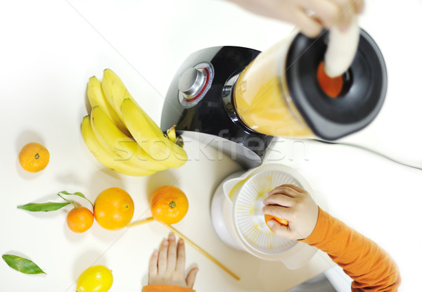 Blender making fruit juice in kitchen Stock photo © zurijeta