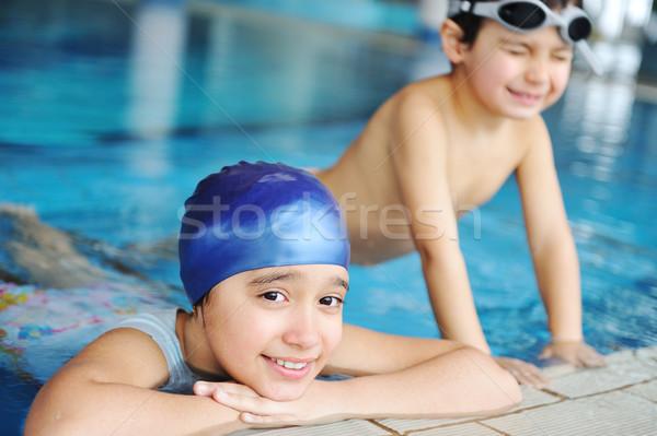çocuklar mavi su yüzme havuzu yaz zaman Stok fotoğraf © zurijeta
