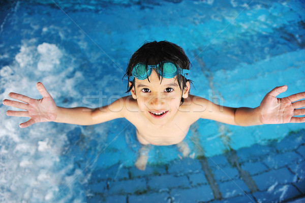 Stock photo: Summertime and swimming activities for happy children on the pool