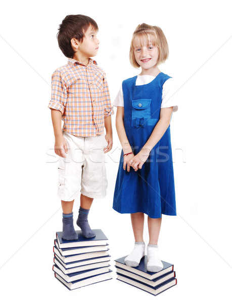 Measuring lenght on books, growning up, boy and girl Stock photo © zurijeta