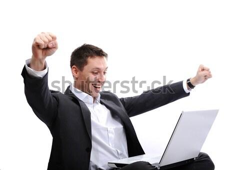 Izgatott férfi laptopot használ karok felfelé levegő Stock fotó © zurijeta