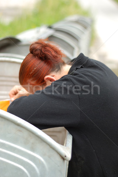 Poverty, middle aged woman searching container  Stock photo © zurijeta