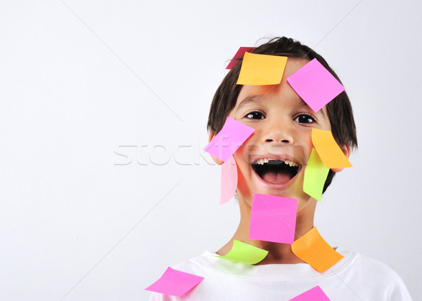 Little boy with memo posts on his face Stock photo © zurijeta